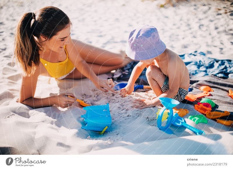 Mother and toddler son playing with toys at beach Lifestyle Joy Happy Leisure and hobbies Playing Vacation & Travel Summer Sun Beach Ocean Child Toddler Woman