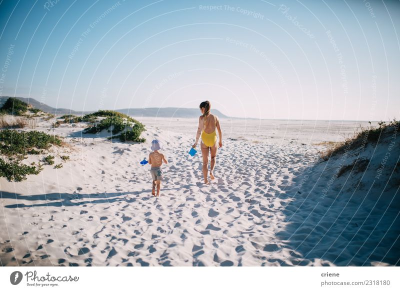 Mother and son walking on the beach together Child Woman Vacation & Travel Summer Sun Ocean Joy Beach Adults Lifestyle Family & Relations Happy Playing