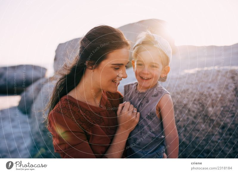 Happy mother and little boy smiling at the beach Child Woman Vacation & Travel Summer Beautiful Ocean Joy Beach Adults Lifestyle Family & Relations Small