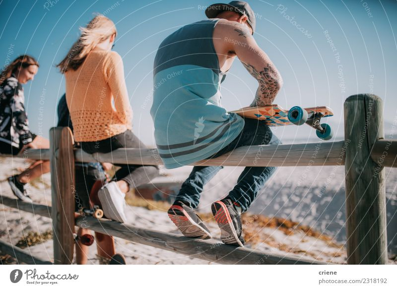 Group of friends hanging out with skateboards at beach Joy Life Leisure and hobbies Summer Beach Human being Woman Adults Man Friendship Culture Cool (slang)