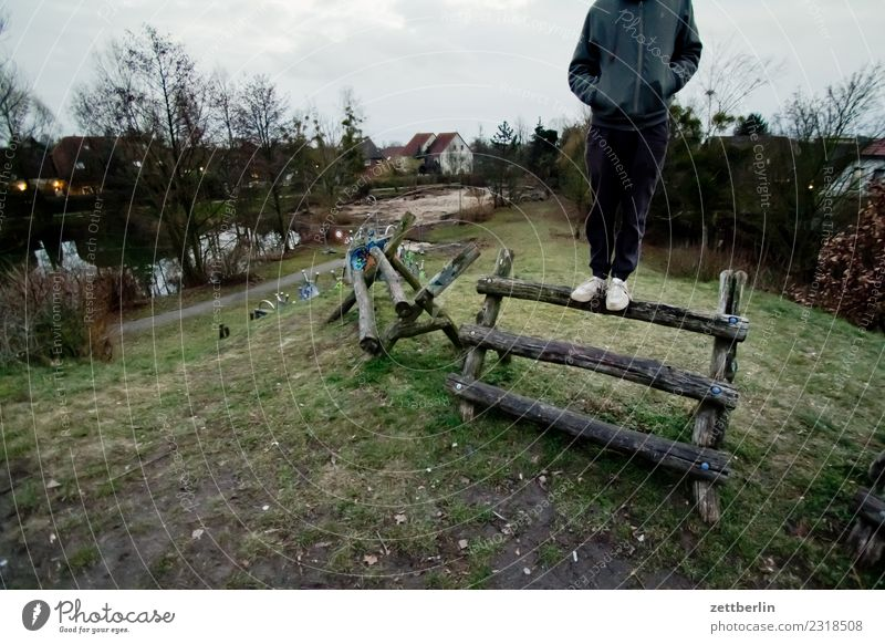 sweetbread Man Human being Youth (Young adults) Young man Stand Balance Mountaineer Climbing facility Joist Wood Hill Playground Copy Space Loneliness Gloomy