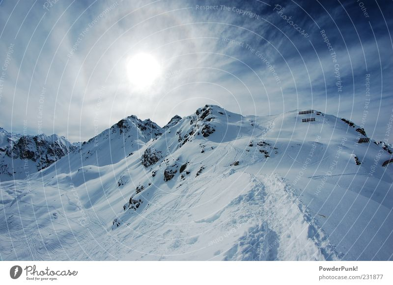 the sky is the goal Tourism Trip Far-off places Freedom Winter Snow Winter vacation Mountain Nature Landscape Sky Sun Sunlight Beautiful weather Hill Rock Alps
