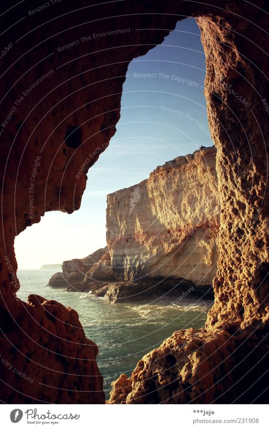 Nature Ocean Landscape Coast Stone Waves Rock Idyll Beautiful weather Bay Hollow Frame Dusk Wanderlust Surf