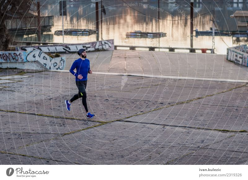 Young bearded athlete runing by the river Fitness Sports Sportsperson Jogging 1 Human being 18 - 30 years Youth (Young adults) Adults Water River Sava Belgrade