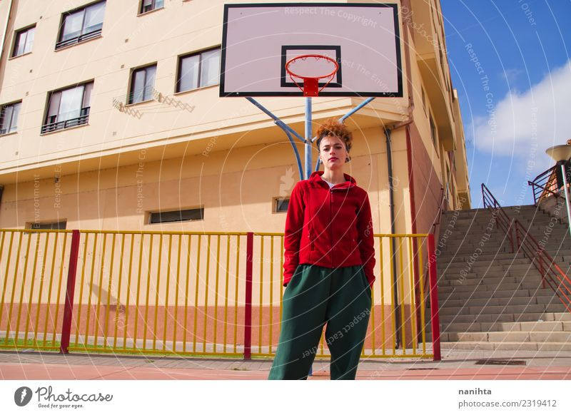 Young redhead woman in a basketball court Human being Youth (Young adults) Young woman Loneliness 18 - 30 years Adults Life Lifestyle Healthy Sports Feminine