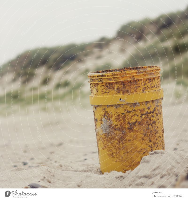 One for all and everything in the bucket Beach Environment Sand Coast Stand Gloomy Yellow Environmental pollution Flotsam and jetsam Beach dune Bucket Nature