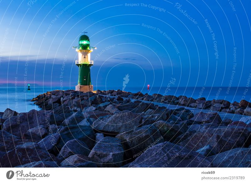 Mole at the Baltic Sea coast in Warnemünde Vacation & Travel Tourism Ocean Nature Landscape Water Clouds Rock Coast Lighthouse Architecture Tourist Attraction