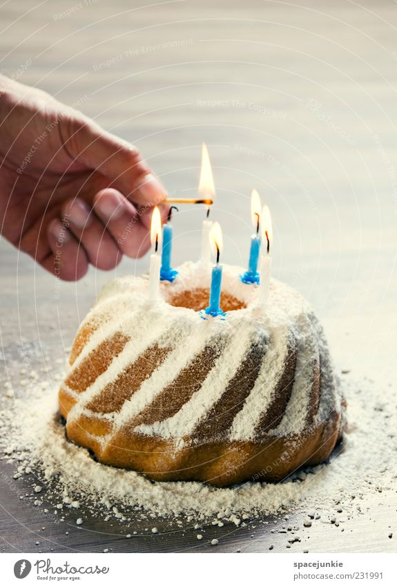 Hand Nutrition Feasts & Celebrations Birthday Masculine Fingers Sweet Candle Cake Delicious Jubilee Match Anticipation Birthday cake Candlelight Ignite