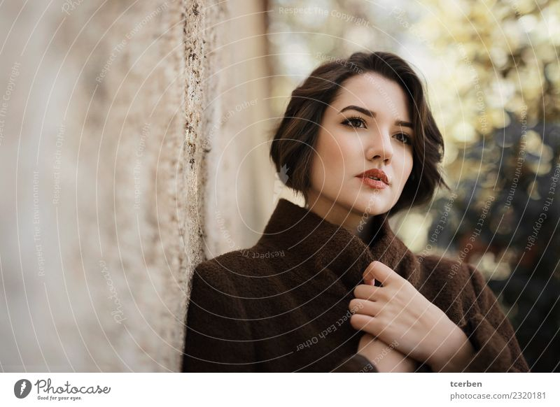 Close up portrait of woman with short hair and coat Human being Youth (Young adults) Old Young woman Beautiful Calm 18 - 30 years Face Adults Wall (building)