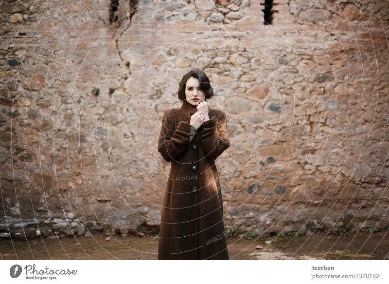 Portrait of woman with short hair and coat with urban background Feminine Young woman Youth (Young adults) 1 Human being 18 - 30 years Adults Winter