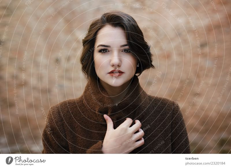 Close up portrait of woman with short hair and coat Human being Youth (Young adults) Beautiful 18 - 30 years Adults Wall (building) Feminine Wall (barrier)