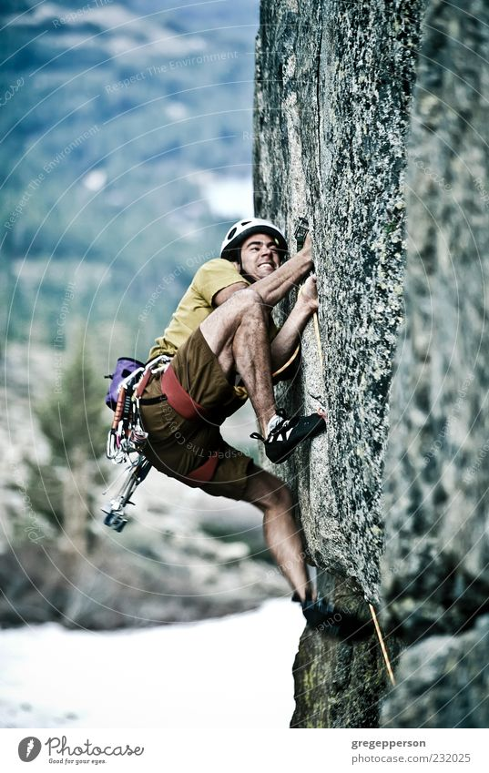 Rock climber clinging to a cliff. Human being Man Nature Youth (Young adults) Adults Sports Mountain Power Tall Adventure Rope Success 18 - 30 years Climbing Trust Peak