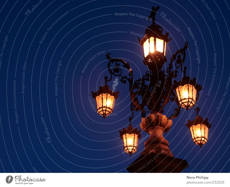 Lantern in Seville Sky Night sky Europe Illuminate Bright Blue Yellow Esthetic Metalware Exterior shot Artificial light Light Light (Natural Phenomenon)