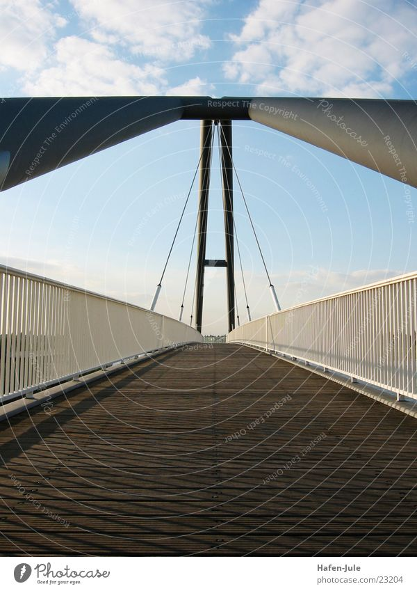 ...and again on his feet Carrier Bridge Handrail Sky wooden planks Lanes & trails Perspective