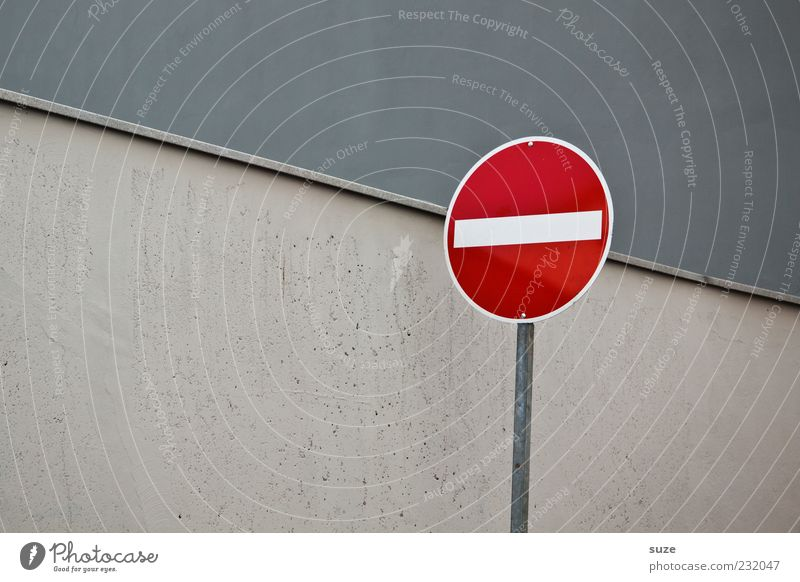 headache Wall (barrier) Wall (building) Transport Road sign Sign Gray One-way street Warning sign Prohibition sign Graphic Colour photo Multicoloured