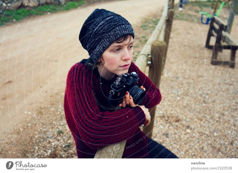 Teen alone in a park with her camera Human being Nature Vacation & Travel Youth (Young adults) Young woman Loneliness Far-off places 18 - 30 years Adults