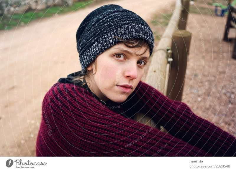 Young sad woman otudoors Lifestyle Style Human being Feminine Young woman Youth (Young adults) 1 18 - 30 years Adults Nature Park Sweater Hat Brunette Wood Wait