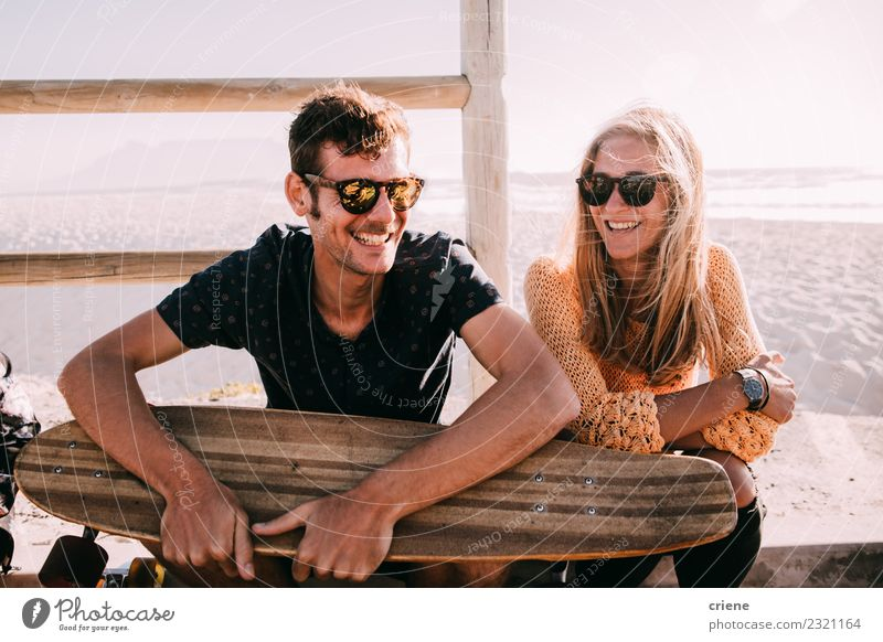 Happy caucasian couple with longboard smiling Lifestyle Joy Leisure and hobbies Vacation & Travel Summer Sunbathing Beach Ocean Woman Adults Friendship Couple
