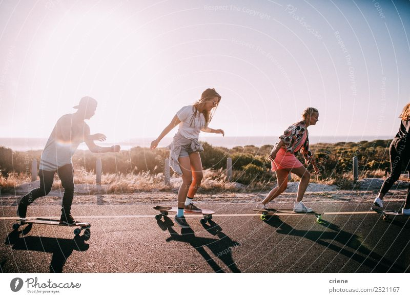Group of hipster friends longboarding on the road in summer Lifestyle Joy Happy Leisure and hobbies Vacation & Travel Summer Sunbathing Beach Ocean Woman Adults