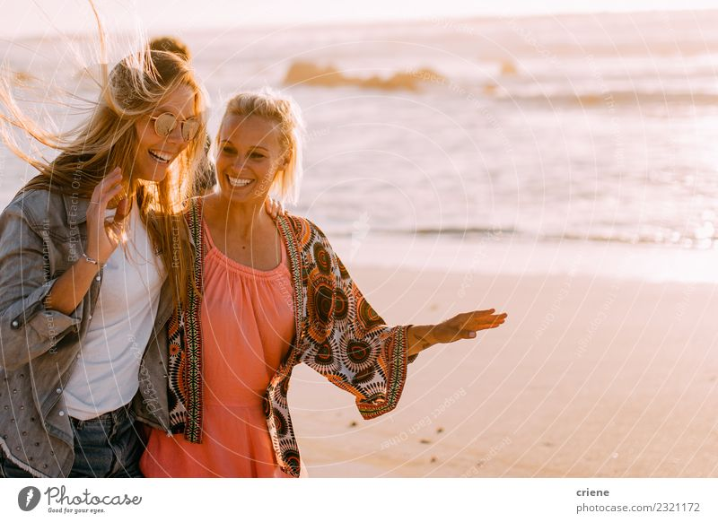 Two young adult girlfriends chatting at beach and laughing Lifestyle Joy Happy Beautiful Vacation & Travel Summer Sun Beach Waves Woman Adults Friendship
