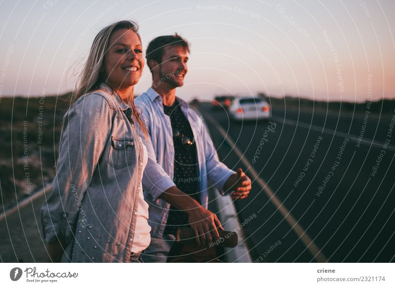 Young adult adventerous couple hitchhiking together Lifestyle Happy Beautiful Leisure and hobbies Vacation & Travel Tourism Trip Adventure Summer Human being