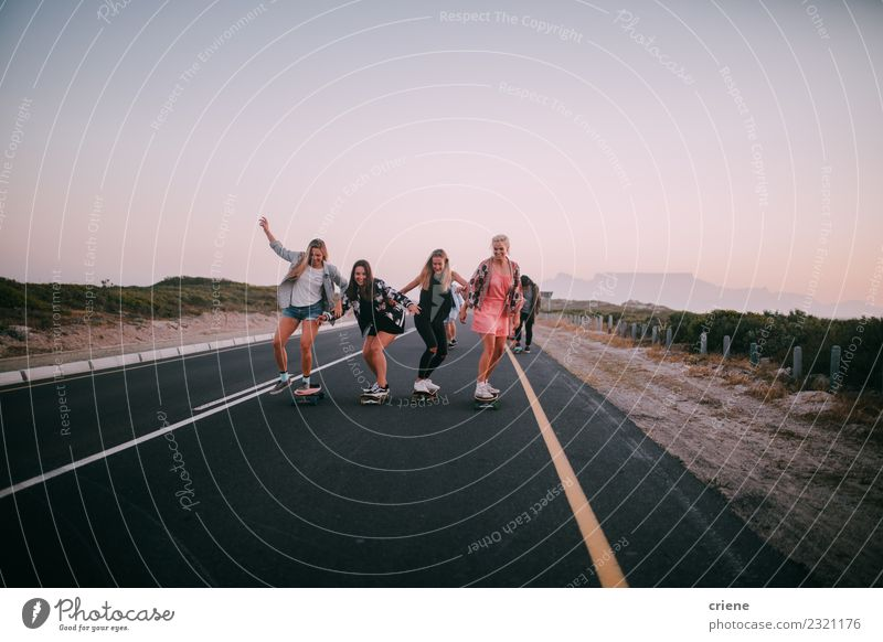 Group of happy girlfriends having fun skateboarding Lifestyle Joy Happy Leisure and hobbies Adventure Freedom Sports Friendship Youth (Young adults) Street