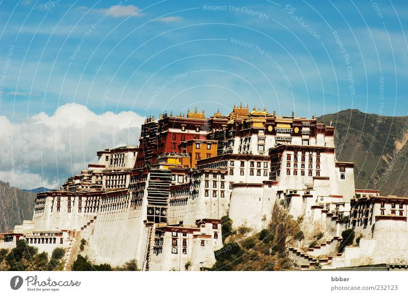 Potala Palace in Lhasa Tibet Vacation & Travel Winter Culture Sky Capital city Old town Castle Building Architecture Tourist Attraction Landmark Blue Yellow Red
