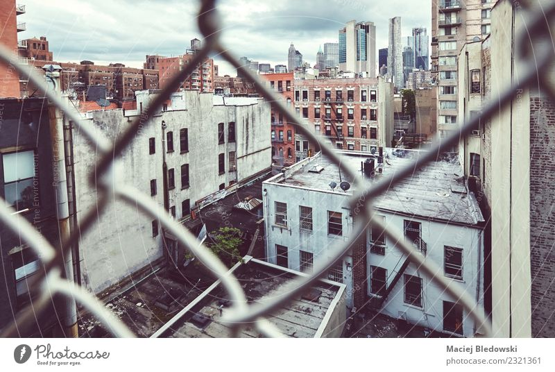 Downtown New York seen through the chain link fence Old Town House (Residential Structure) Building Facade Living or residing Flat (apartment) Retro Dirty