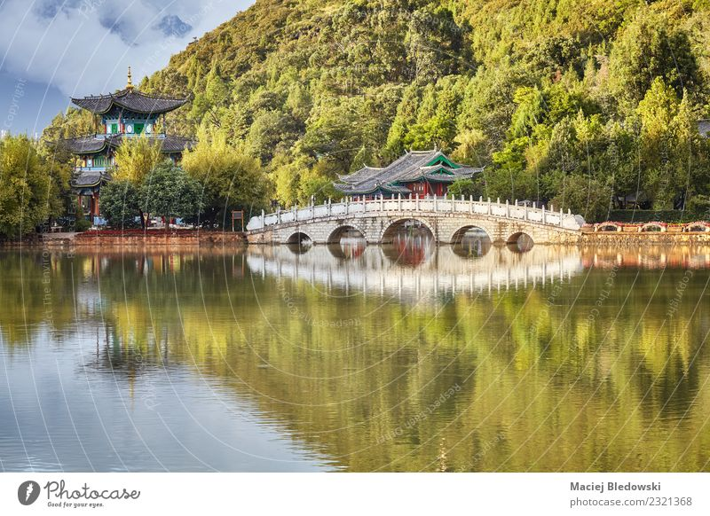 Suocui Bridge in the Jade Spring Park in Lijiang, China Swimming pool Vacation & Travel Tourism Trip Sightseeing Nature Landscape Hill Lake Building Serene Calm