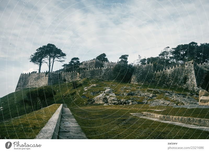 Wall and stone castle in winter on a hill in Baiona, Galicia Spain Beautiful Vacation & Travel Tourism Trip Winter Garden Nature Landscape Sky Bad weather Park