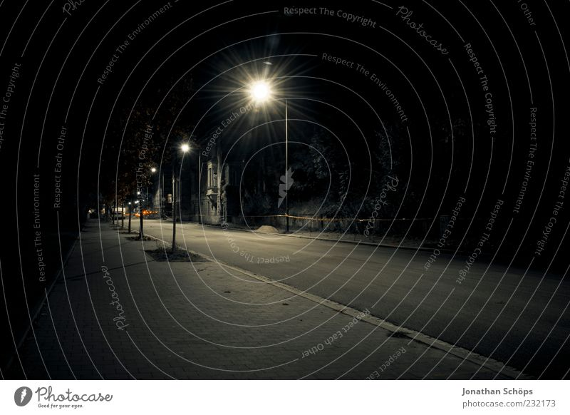 Empty Weimar Traffic infrastructure Street Street lighting Lighting Observe Threat Dark Creepy Emotions Loneliness Fear Dangerous Nerviness Animosity Risk