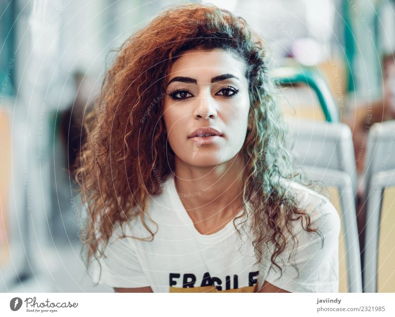 Arabic woman sitting inside subway train. Lifestyle Beautiful Hair and hairstyles Vacation & Travel Tourism Trip Human being Feminine Young woman