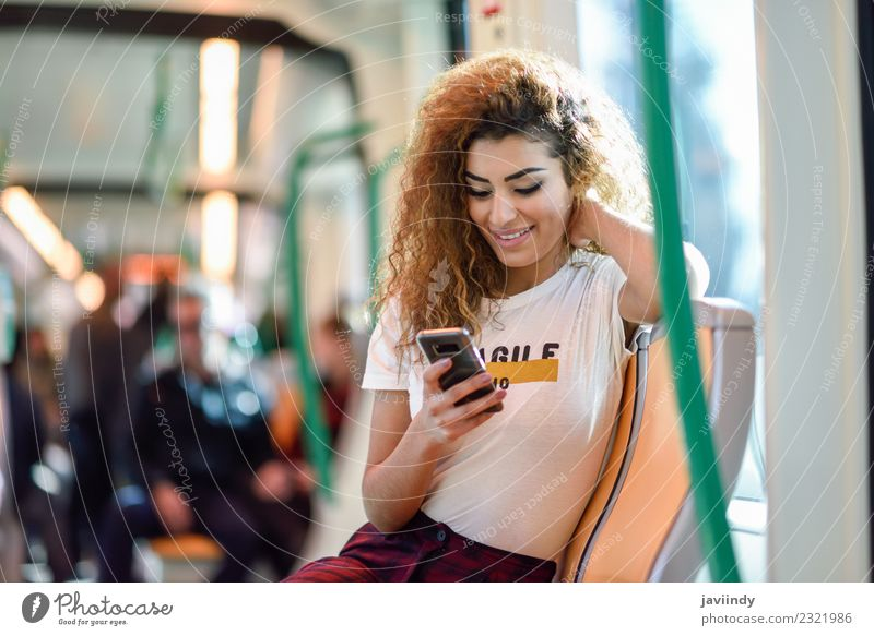 Woman inside subway train looking at her smartphone Lifestyle Beautiful Hair and hairstyles Vacation & Travel Tourism Trip Telephone Human being Feminine