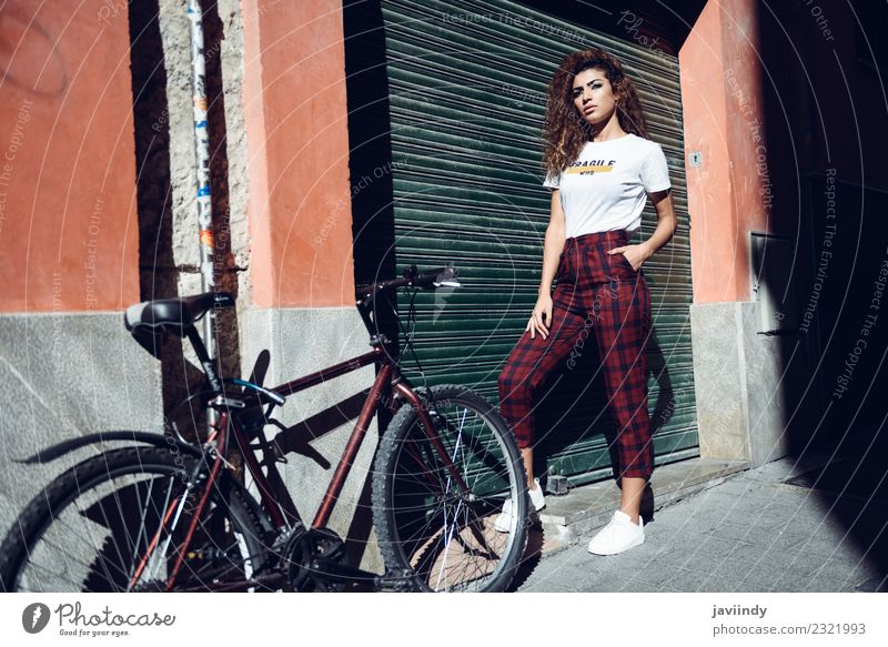 Woman in casual clothes in the street near a bicycle Lifestyle Beautiful Hair and hairstyles Summer Human being Young woman Youth (Young adults) Adults 1