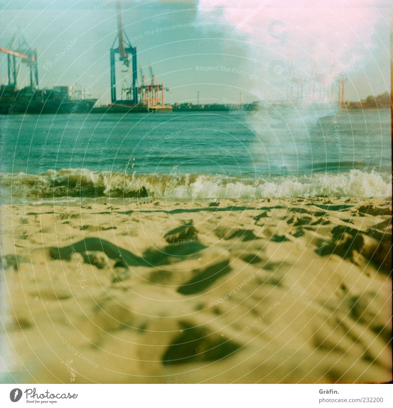 beach Relaxation Summer Sun Beach Waves Industry Sand Water Sunlight River bank Hamburg Harbour Blue Yellow Break Crane Elbe Light leak Analog Colour photo