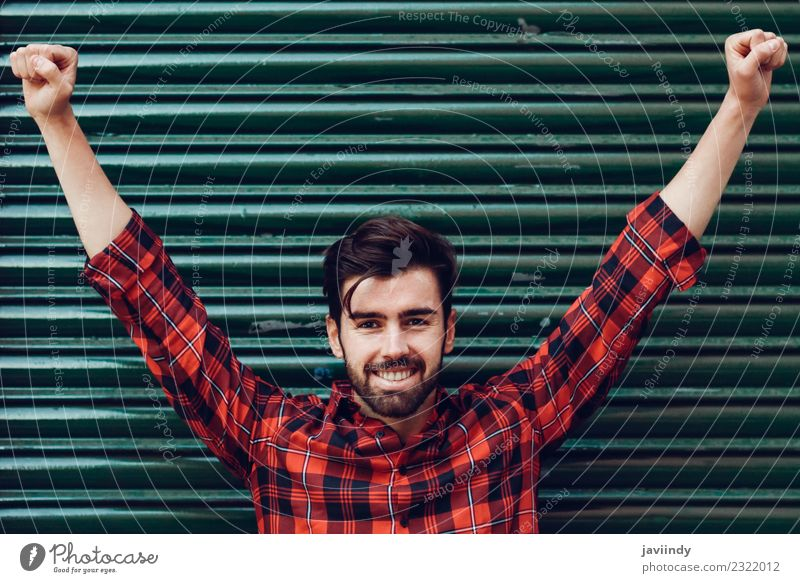 Young smiling man with open arms wearing a plaid shirt Lifestyle Style Beautiful Hair and hairstyles Human being Young man Youth (Young adults) Man Adults