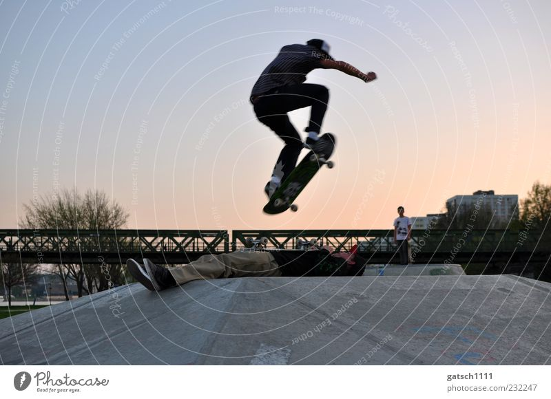 trust Skate park Trick jump Sports Skateboard Young man Youth (Young adults) Friendship Bridge Concrete Flying Jump Exceptional Athletic Crazy Joy Cool (slang)