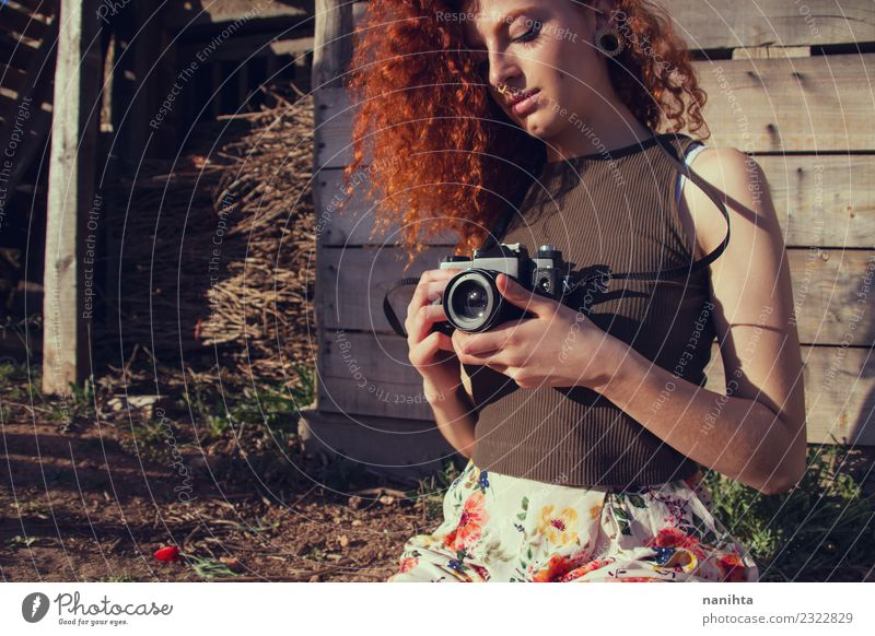 Young redhead woman holding an analog camera Lifestyle Style Hair and hairstyles Vacation & Travel Tourism Adventure Summer Summer vacation Human being Feminine