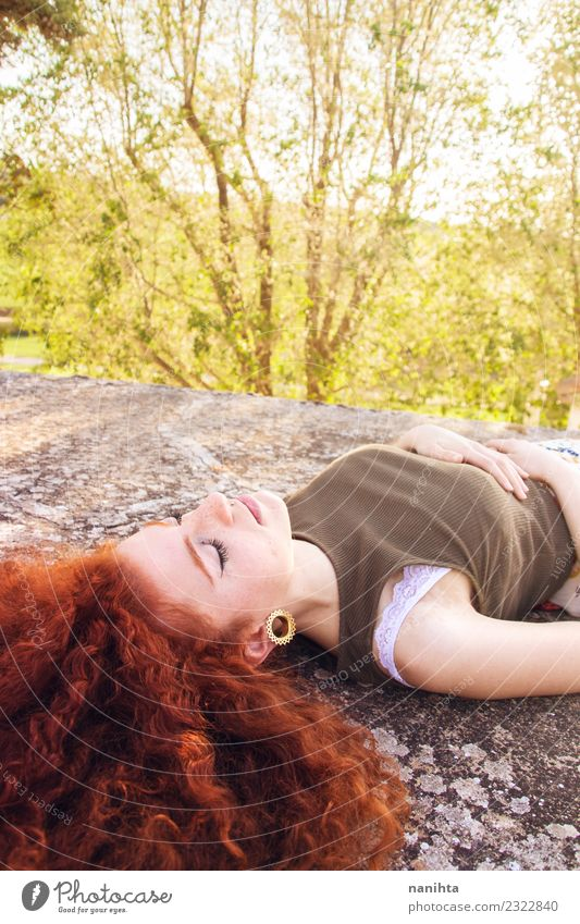Young and redhead woman is having a sun bath Human being Nature Vacation & Travel Youth (Young adults) Young woman Summer Beautiful Green Sun Tree Relaxation