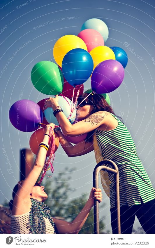 Human being Woman Joy Adults Love Lifestyle Friendship Beautiful weather Touch Balloon To hold on Team Tattoo Kissing Blue sky 30 - 45 years