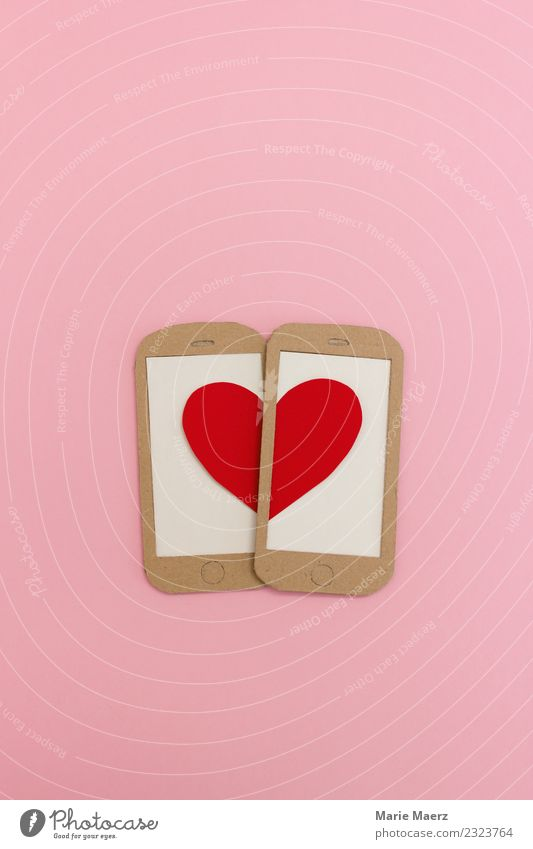 Two mobile phone displays form a heart. Lifestyle Joy Happy Flirt Valentine's Day Cellphone PDA Entertainment electronics Internet Heart Communicate Love