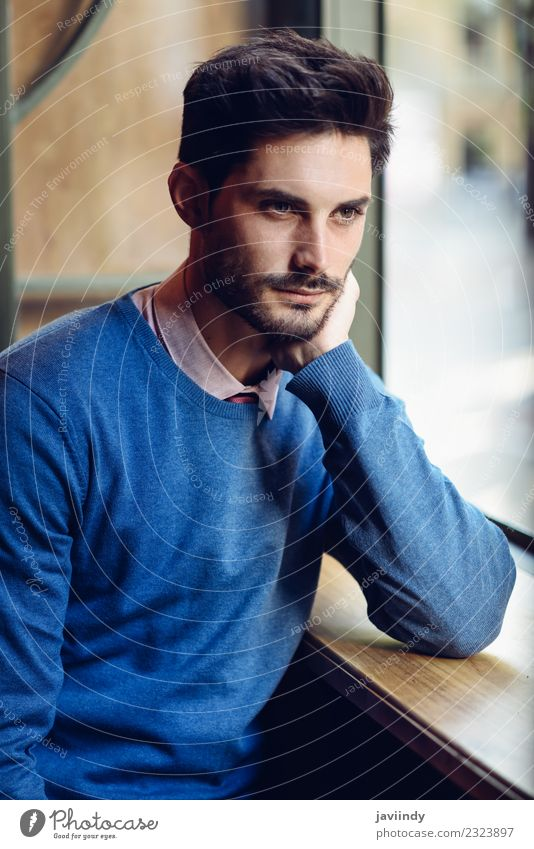 Thoughtful man with lost look near a window in a modern pub Human being Youth (Young adults) Man Beautiful Young man Calm 18 - 30 years Adults Lifestyle