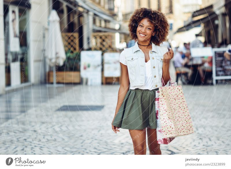 Young black woman with shopping bags in the street. Woman Human being Youth (Young adults) Young woman Beautiful Joy 18 - 30 years Black Adults Street Lifestyle