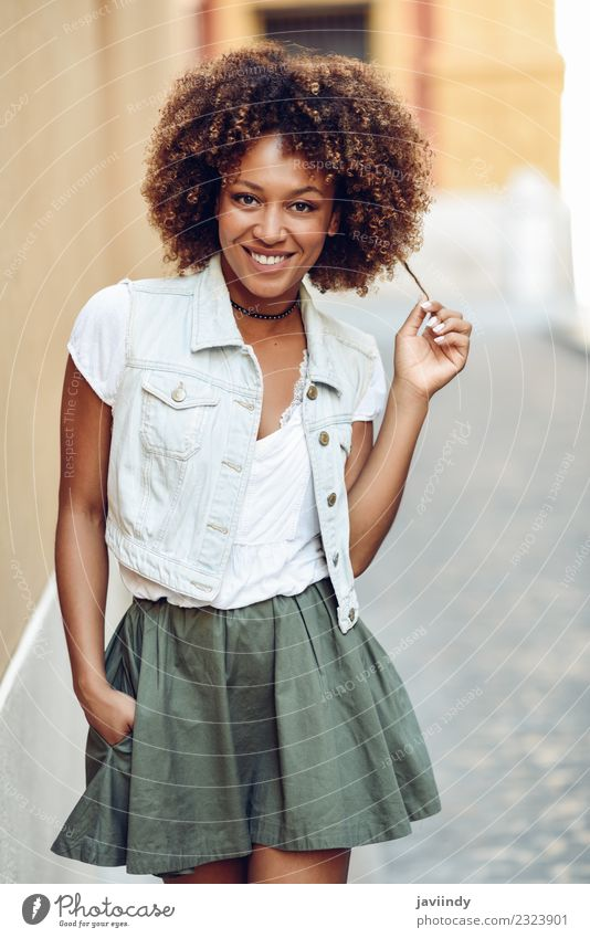 Young black woman, afro hairstyle, smiling in the street Woman Human being Youth (Young adults) Young woman Beautiful 18 - 30 years Black Face Adults Street
