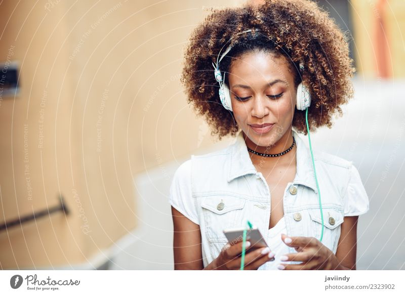 Black woman listening to the music with headphones Lifestyle Style Joy Happy Beautiful Hair and hairstyles Face Music Telephone PDA Human being Young woman
