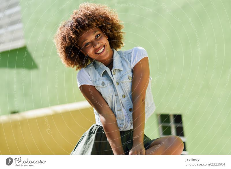 Young Black Woman Afro Hairstyle Smiling Outdoors A Royalty Free