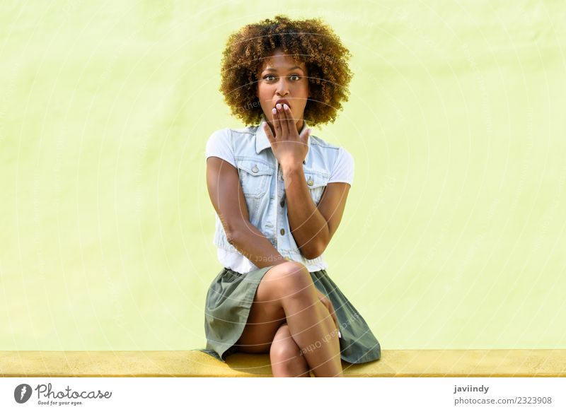 Woman sitting on a wall with a surprise face Lifestyle Style Happy Beautiful Hair and hairstyles Face Human being Young woman Youth (Young adults) Adults 1