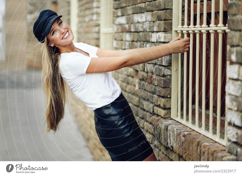 Young blonde woman smiling near a brick wall. Lifestyle Style Beautiful Hair and hairstyles Human being Feminine Young woman Youth (Young adults) Woman Adults 1