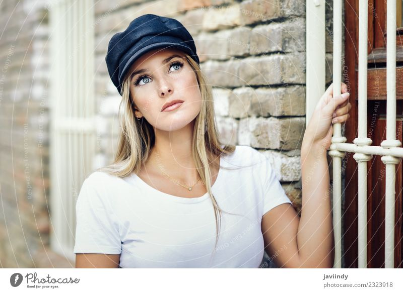 Young blonde woman standing near a brick wall Lifestyle Style Beautiful Hair and hairstyles Summer Human being Feminine Young woman Youth (Young adults) Woman