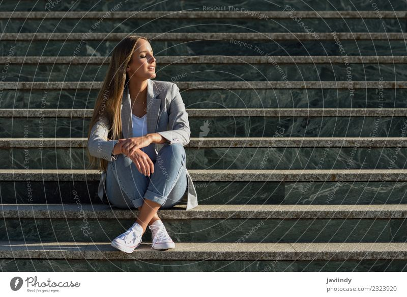 Blonde woman with eyes closed in urban steps Lifestyle Style Beautiful Hair and hairstyles Human being Feminine Young woman Youth (Young adults) Woman Adults 1